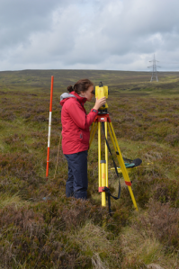 Placement student Carly Robertson using a total station theodolite at Muirshiel